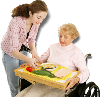 caregiver assisting patient in eating her food