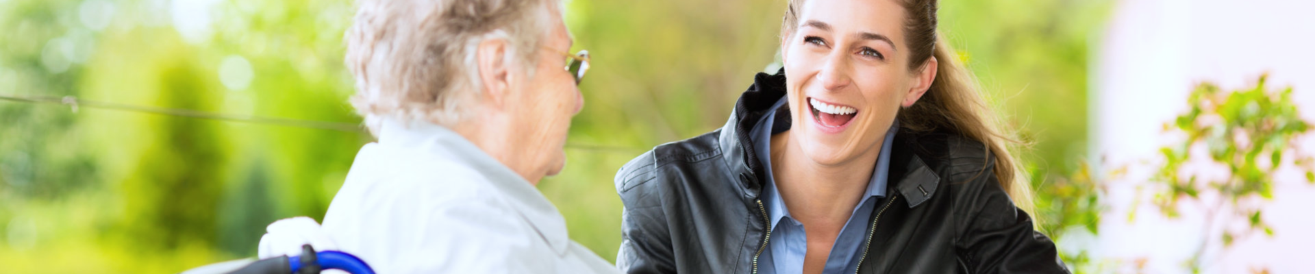 caregiver smiling to patient