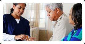 caregiver giving medicines to patients