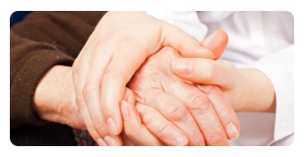 caregiver holding the hands of the patient